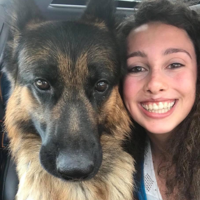 An Image of Allie Pawlow and her dog.